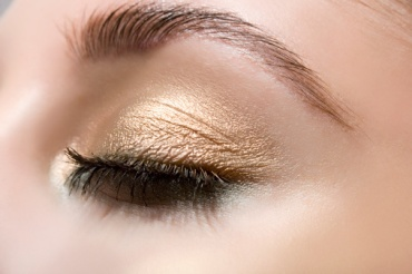 Woman wearing gold eye shadow